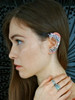 Teresa is modeling the wave rider mermaid ear wrap in silver with the tide pool ring with gem stones, and Nouveau Swirl Ring in silver