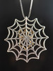 Back of Bronze Black Widow Charm With Silver Spider Web Charm Without Chained Spider