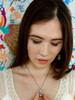 Teresa is pictured wearing the Christelle pendant and matching earring set