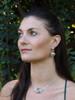 Model is wearing Angler Fish Earrings & Rip Curl Wave Pendant w/ Gemstone