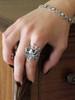 Model is wearing Spider Ring with Arachnid Spider Link Bracelet