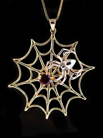 Large Gold Spider Web and Silver Spider Pendant.