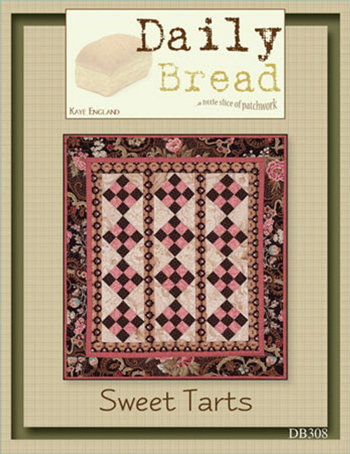 "Fresh from the oven, it's a new batch of quick and simple patterns, fun for all skill levels. Created with a pinch of inspiration and a dash of fun, this new pattern line from Kaye England Publications is the best thing since sliced.....well you get the idea! Small packaging - (5 1/2H x 4 1/4W, four full color pages), small projects, small price!   These vertical rows of nine-patch blocks look like sweet candies lined up in a row. Could be great scrappy and also easily enlarged. Bet you can't make just one!   Finished size: 21"" x 25"""