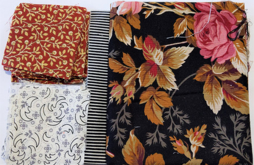 """Fabrics shown are exactly what's included in this kit.     64 pre-cut 2 ½"""" squares     1/8 yd border ( cut 1 ½)     ½ yd border (cut up to 6"""" wide)"""