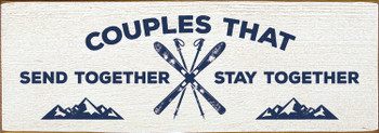 Wooden skiing sign on Cottage White with Blue lettering
