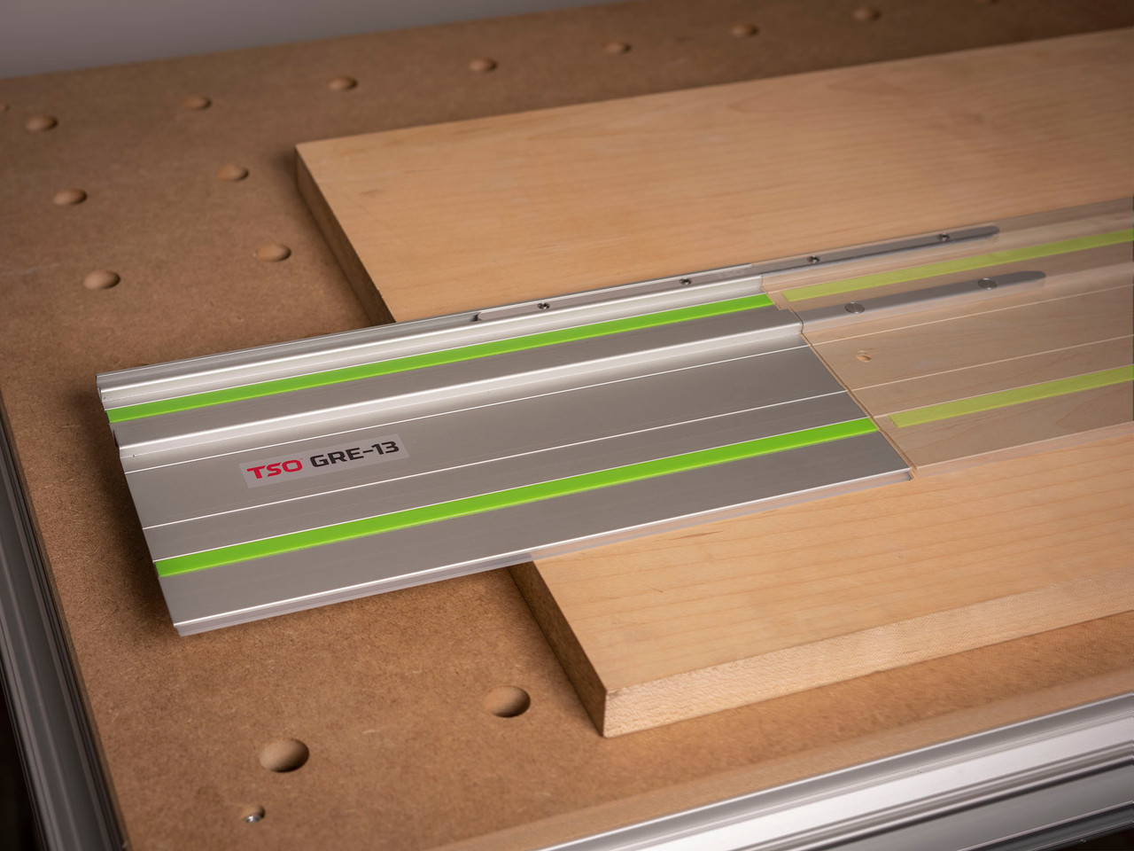 Image depicting the GRE-13 Guide Rail Extension connected to a Festool guide rail.