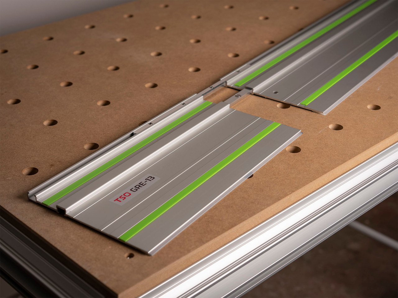 The GRE-13 rapidly connects to Festool guide rails as shown here.