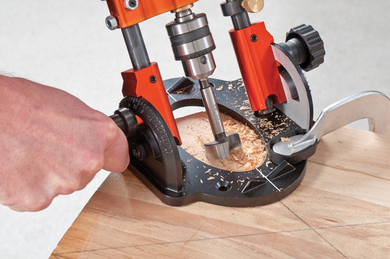 The Quadrents on both sides of the base allows the assembly to be tilted + or - 60˚ and clamped in place with the clamping knob.