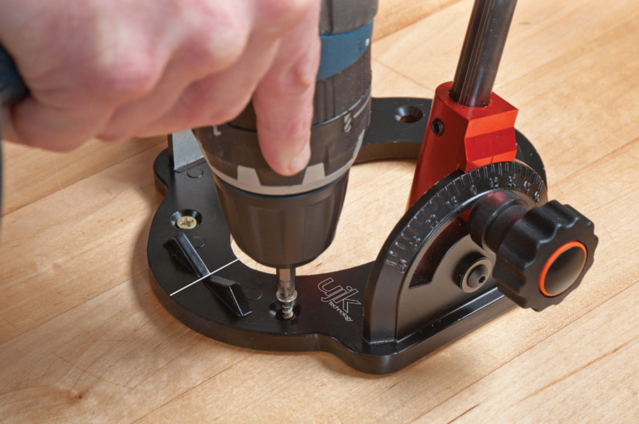 The UJK drill guide can be fixed in position using the four countersink holes in the drill guides base, see picture above.