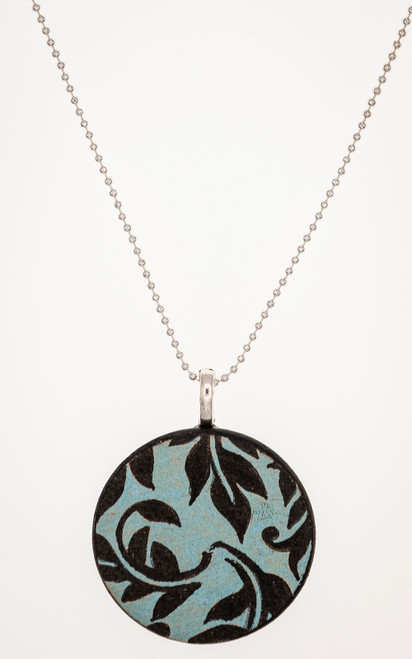 Casual blue and black pendant on a silver tone ball chain