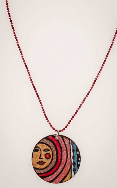 Red and pink pendant with moon imagery