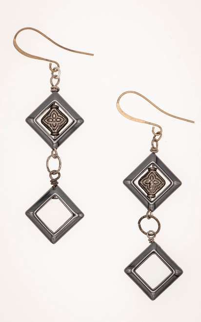 Diamond-shaped hematite beads along with silver tone spacers form these earrings