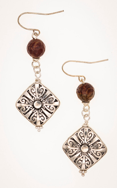 Stunning earrings with an engraved silver pillow bead