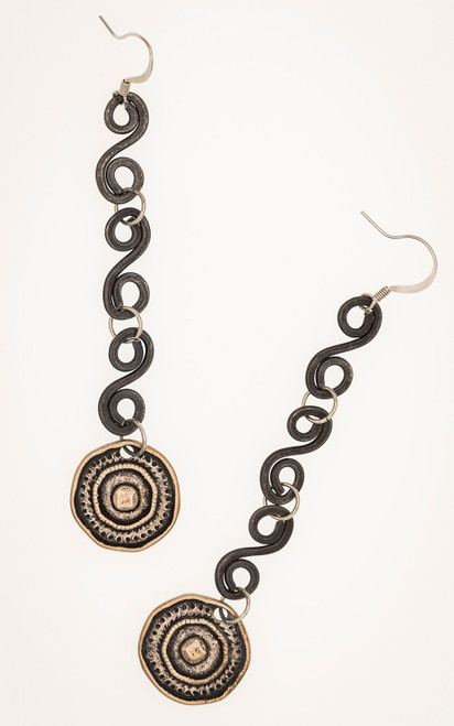 Hand forged iron swirls and vintage button reproductions make a beautiful pair of earrings