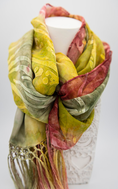 Hand painted burnout satin silk scarf in green and red with hand rolled edges and fringe