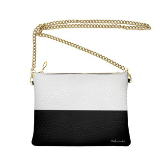 Black and white leather clutch bag with chain