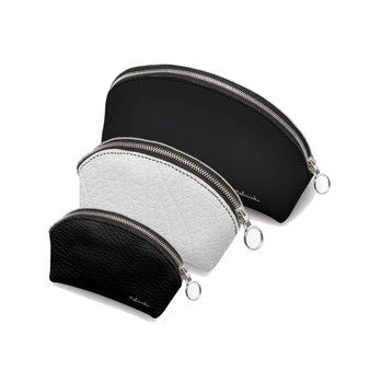 Set of 3 black and white leather cosmetic bags