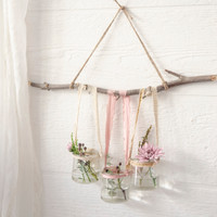 Upcycled Yogurt Containers Wall Decor and Storage Idea by Christen Hammons