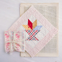 Flea Market Floral Fabric, Red Quilted Square, and Text Bundle