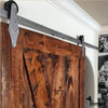 installed hinge style barn door hardware hangers