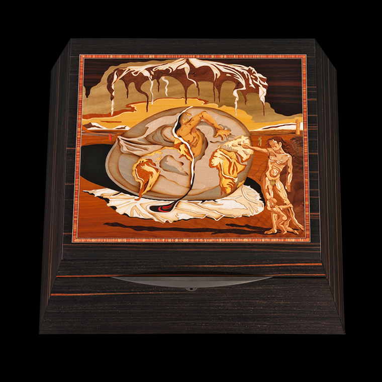 For Sale SALVADOR DALI – EBONY MACASSAR Limited Edition Watchwinder. Artist Giuseppe Miniero Limited Edition cases exceptional in both quality and appearance. Intarsia designs are created with hundreds of tiny pieces of wood whose puzzle-like assembly may require up to 25 different exotic wood varieties.  This gorgeous watchwinder features Salvador Dali's 'Geopoliticus Child Watching the Birth of the New Man'.  It is available with our patented Rotorwind technology, and runs on Lithium batteries.