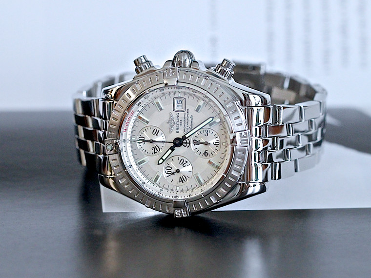 For sale Breitling Chronomat Evolution A13356 Silver Dial Stainless Steel Bracelet 44mm available online www.legendoftime.com and in store in our Chicago downtown showroom.