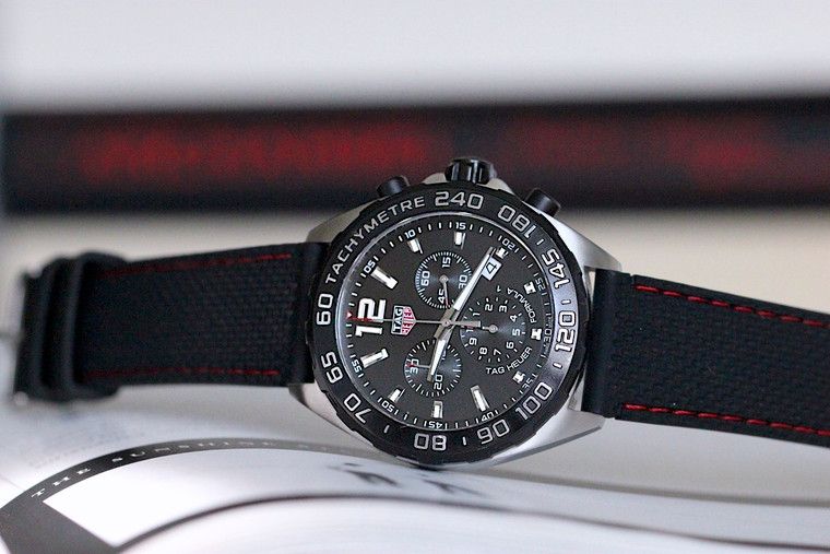For sale used TAG HEUER Formula 1 Quartz Chronograph 43mm Black Titanium carbide steel bezel mens sports watch, complete with original box and papers. Available for purchase online and in store at Legend of Time Chicago.