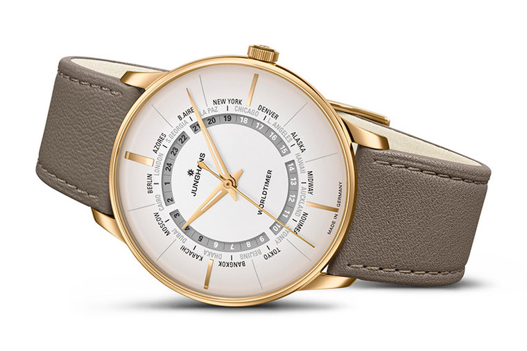 JUNGHANS MEISTER WORLDTIMER 027/5012.02 Mens 24 Time Zone Watch   SPECIAL ORDER - DELIVERY 6-8 Weeks The new Meister Worldtimer is an elegant embodiment of the earth's perpetual motion. All 24 time zones are available to the wearer at a glance by correlating the hour disc with the cities represented on the dial. While the dial reflects the progression of time across the globe, the glass back of the case provides a view of the intricate self-winding movement.     This sense of global networking is the inspiration behind the new Meister Worldtimer from Junghans: A timepiece that exhibits most elegantly the perpetual movement of our world. The radial aperture in the dial reveals a grey hour disc which displays the time in 24 different loca-tions simultaneously. A specific city is allocated to every hour of the day in its respective time zone. Should one wish to send a Good Night message to loved ones back home while away on a business trip, the night time hours between 7pm and 6am are represented in black to provide an invaluable guide.  Movement:  Movement: Self-winding movement J820.5 with 24-hour display and power reserve of up to 42 hours   Case: Stainless steel or PVD-coated, Ø 40.4 mm, height 10.4 mm, 5-times screwed case back with mineral crystal   Glass:  Sapphire crystal with anti-reflection coating on both sides   Dial: Matt silver-plated   Hands: With environmentally friendly Superluminova luminous substance   Strap:  Calf leather strap in brown with PVD-coated buckle   Water-Resistance:  up to 5 bar