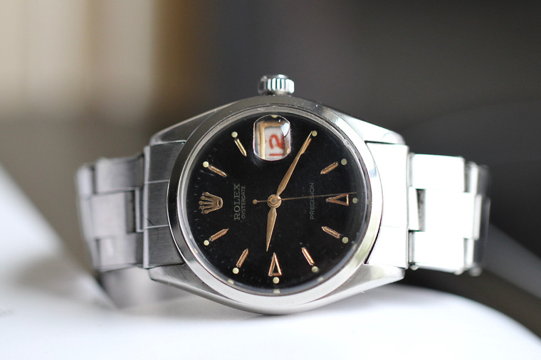Vintage Rolex Oyster Date Precision 6294, in stainless steel featuring a  Black Dial with Gold hour Markers. Production around 1957.   Roulette Calendar Date.    Great condition vintage Rolex, please take a look at detailed pictures of the dial and hour markers, bracelet in great condition (rarely seen).   If you have any questions, please let us know.