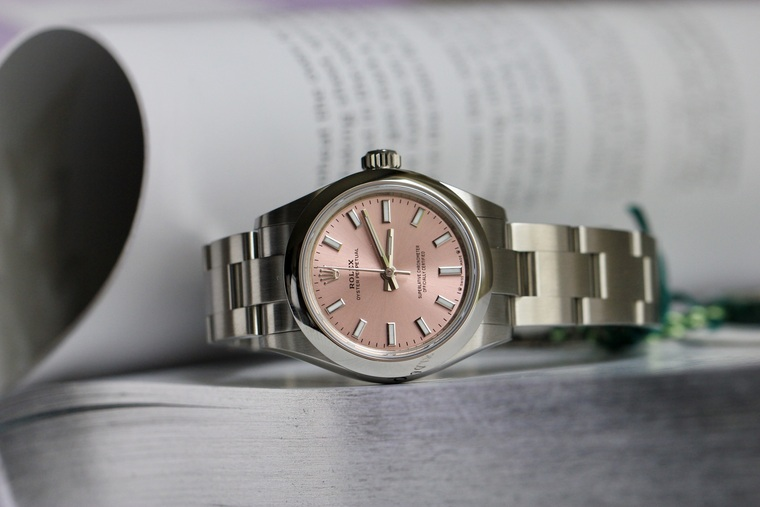 For sale, unworn condition, complete box and documents.  Rolex Ladies Watch Oyster Perpetual 28mm Pink Dial Steel Bracelet.  Available in Chicago Legend of Time Store, free shipping in US.  2 Year warranty