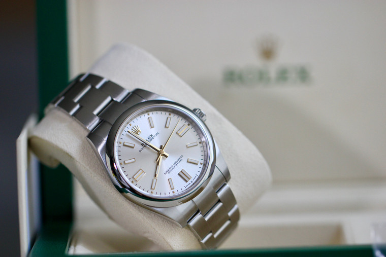Rolex Oyster Perpetual 41mm model 124300 Silver Dial, Smooth Bezel Oyster Bracelet, Unworn Complete.  Available for sale in stock at Legend of Time Chicago watch store.
