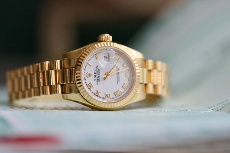 For sale Rolex Lady-Datejust 26, Yellow Gold Fluted Bezel, White Dial with Gold Roman Numerals, Gold President Bracelet, Model 179178, Complete Box & Papers.  In stock at Legend of Time Chicago Watch Store.  Please contact us for price.