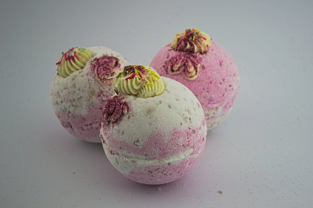 handmade bath bomb in strawberry with shea butter