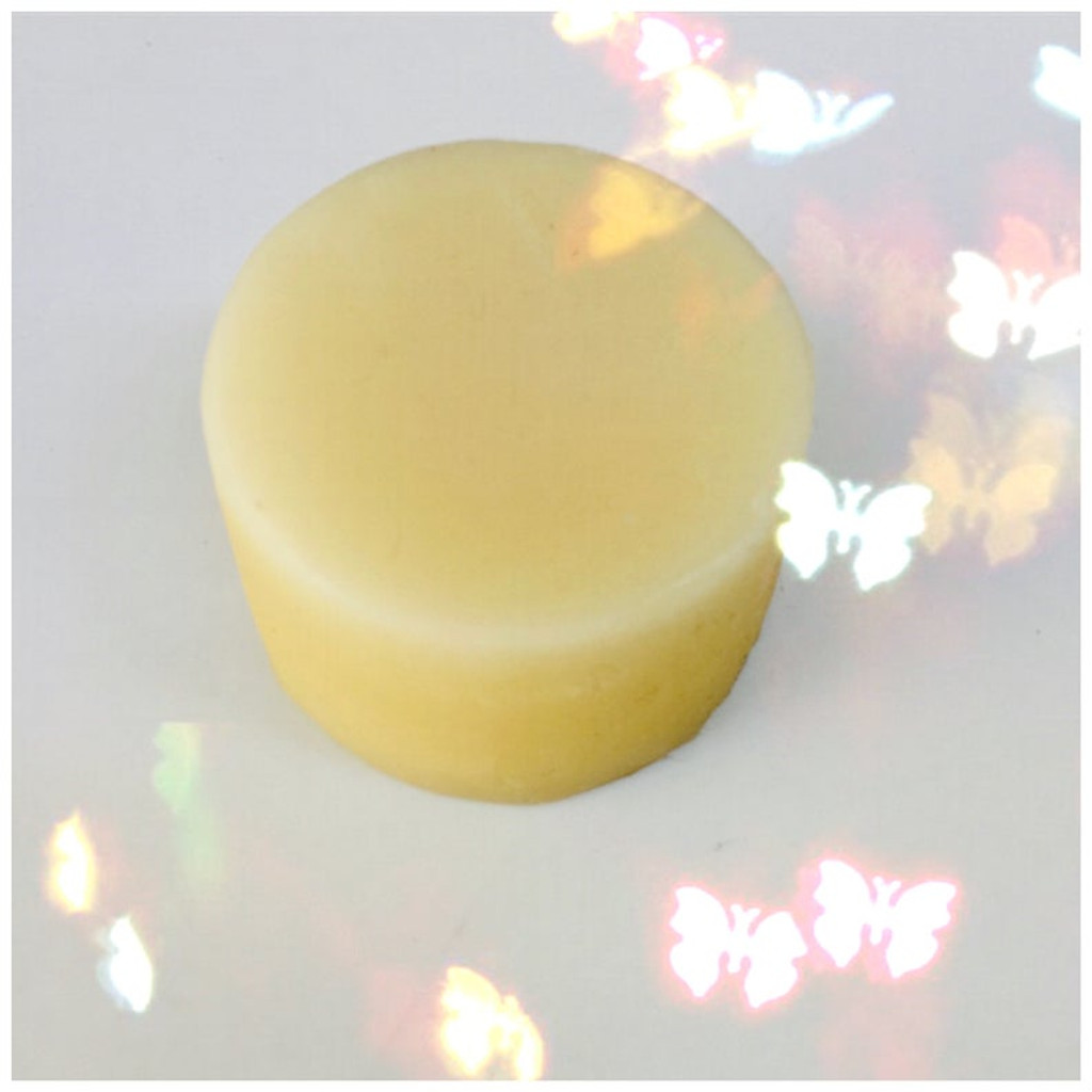 handmade coconut conditioner bar in a tin