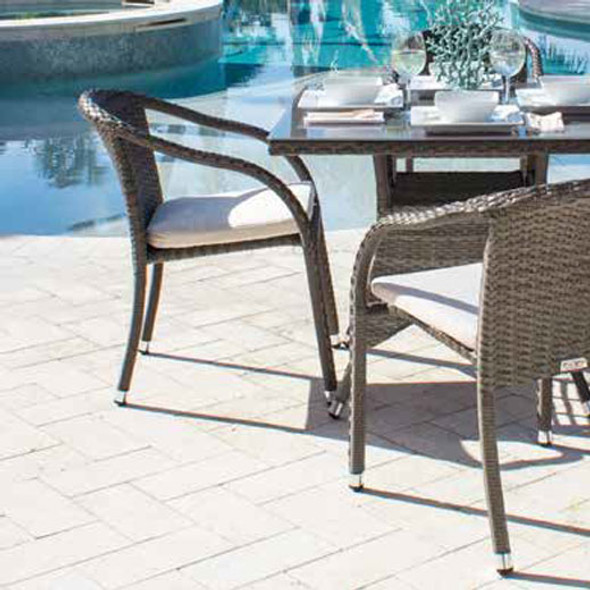 Ultra Outdoor Stackable Woven ArmChair with a cushion in a 100% polyester fabric