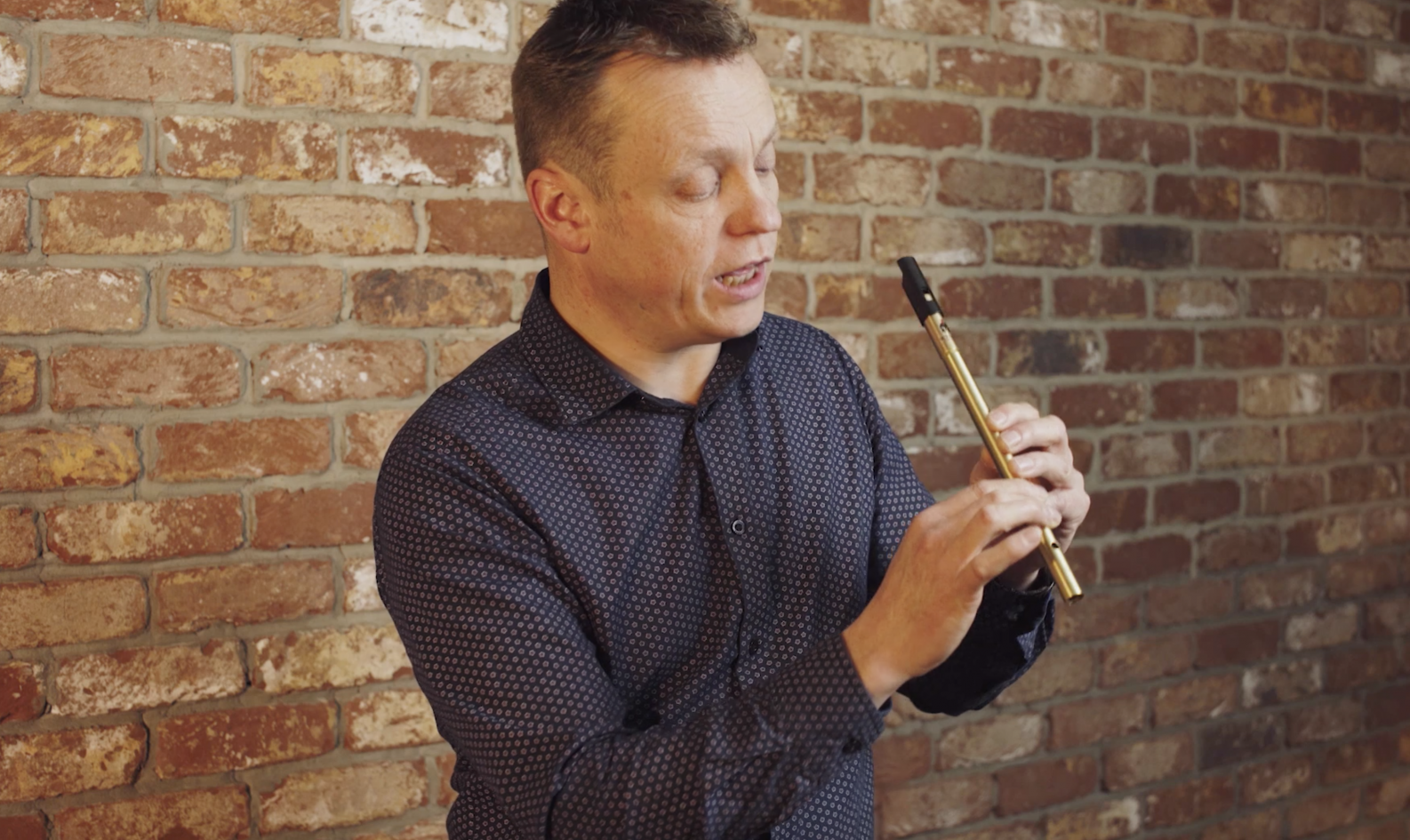 John O'Brien demonstrating the Irish tin whistle as part of the McNeela Ultimate Tin Whistle Lesson Course