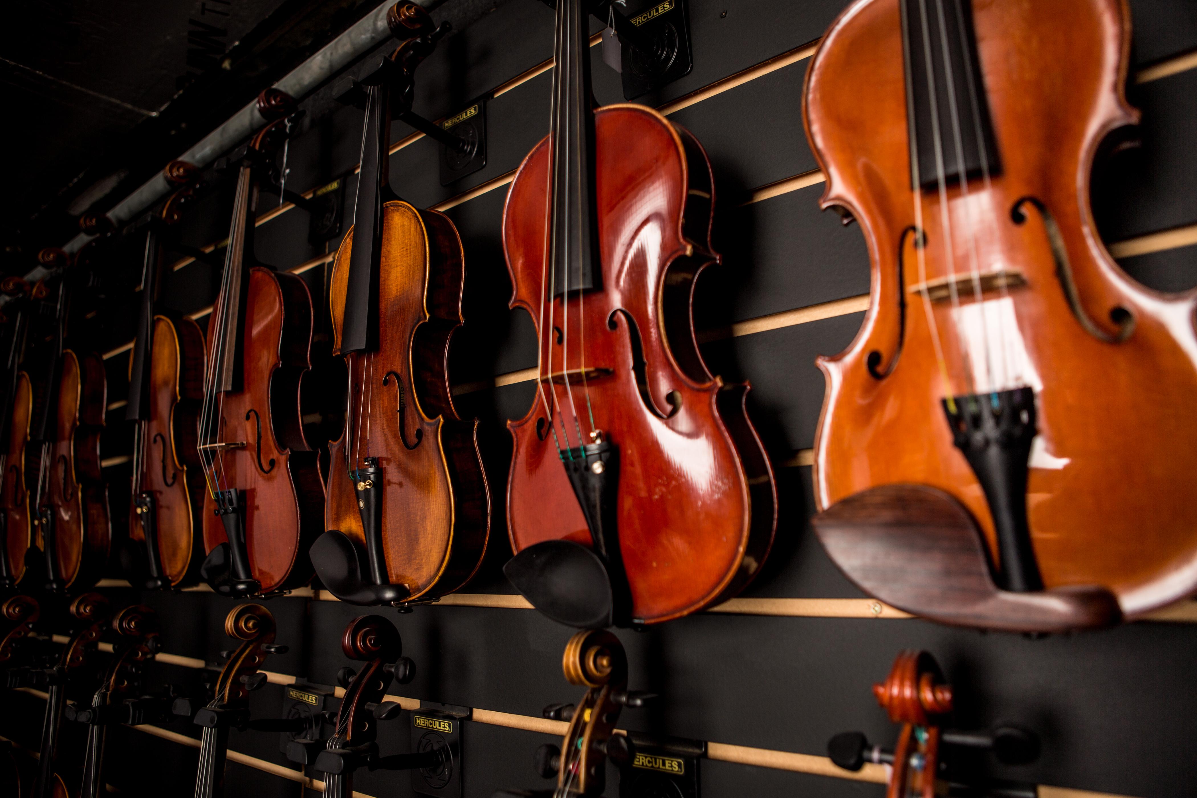 mcneela-instruments-workshop-fiddle-wall.jpg