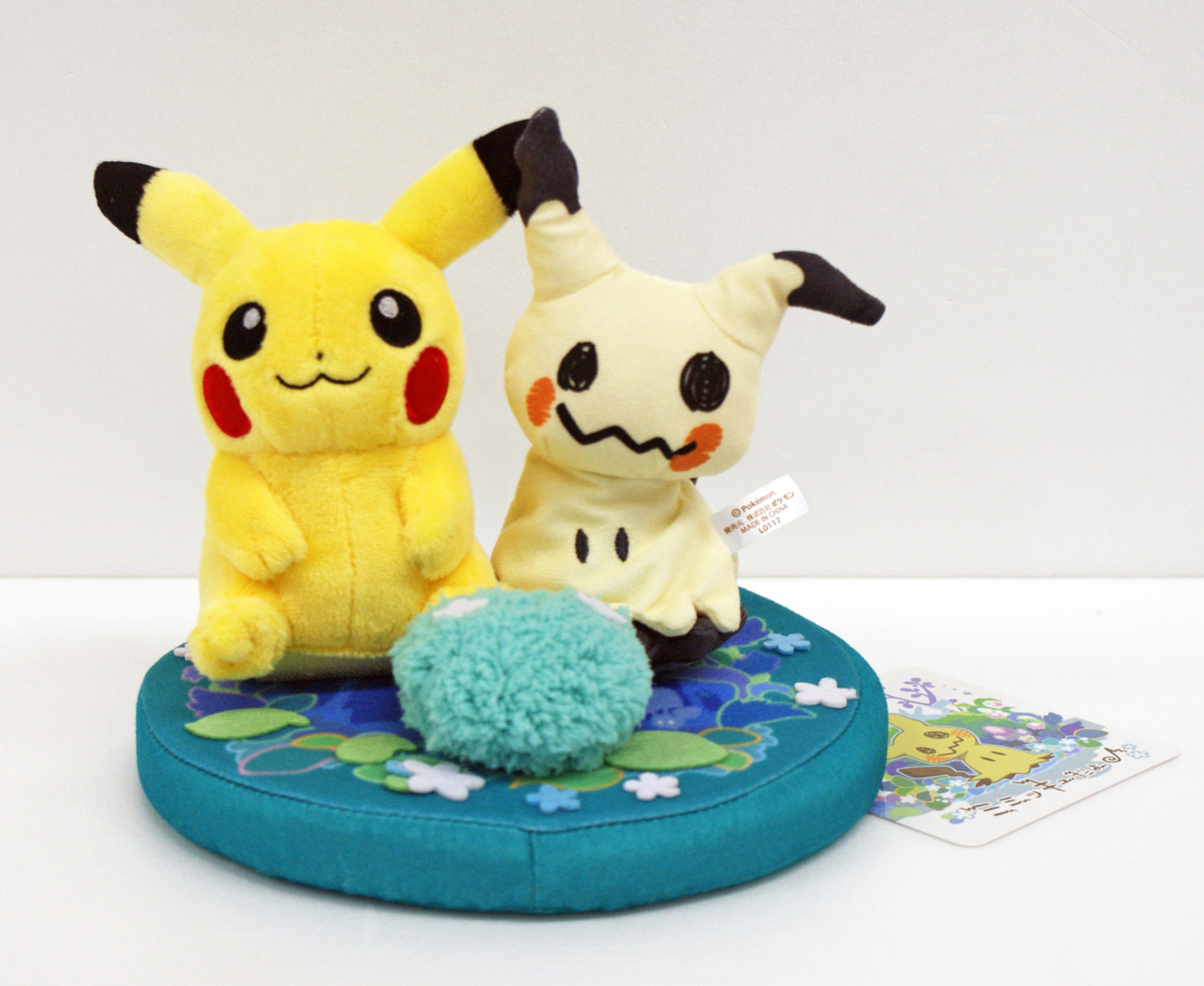 A plush showing Mimikyu and Pikachu together.