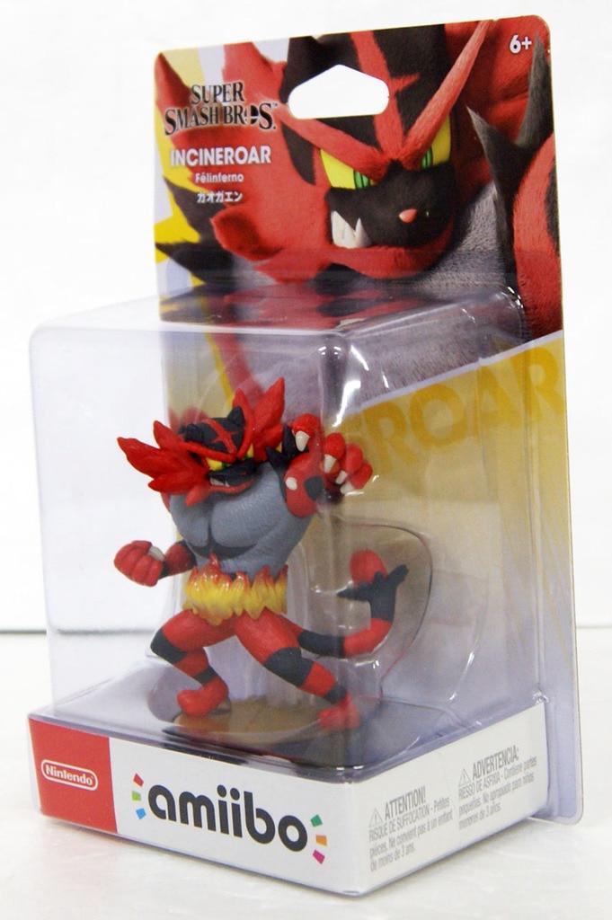 An Incineroar Amiibo in a box.