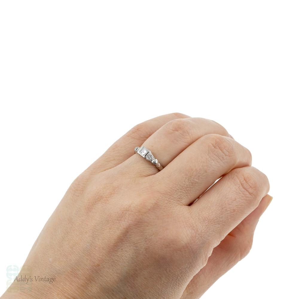 Square Step Cut Diamond Engagement Ring, Platinum Bezel Set Band. Circa 1990s.
