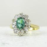 Vintage Green Tourmaline Ring with Diamond Halo, 18 Carat Gold Engagement Ring or Dress Ring, Circa 1940s.