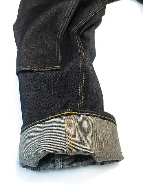 Close-up of tapered 3 needle (triple stitch) carpenter jeans.