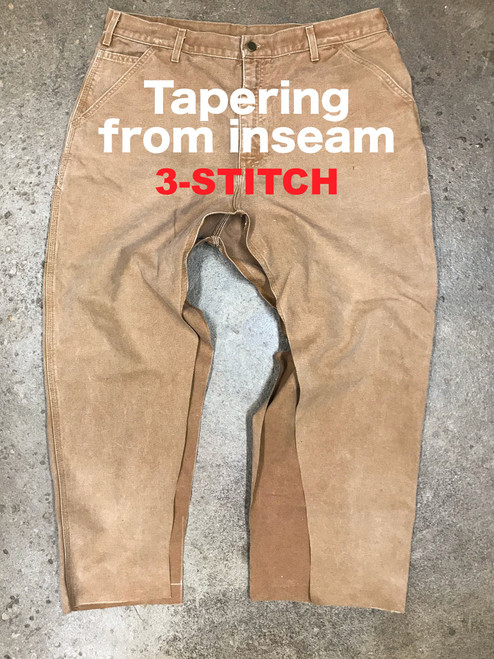 3-Stitch work pants tapering from the inseam.