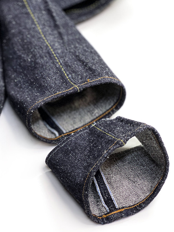 Inseam of jeans shorten with chain stitch hemming