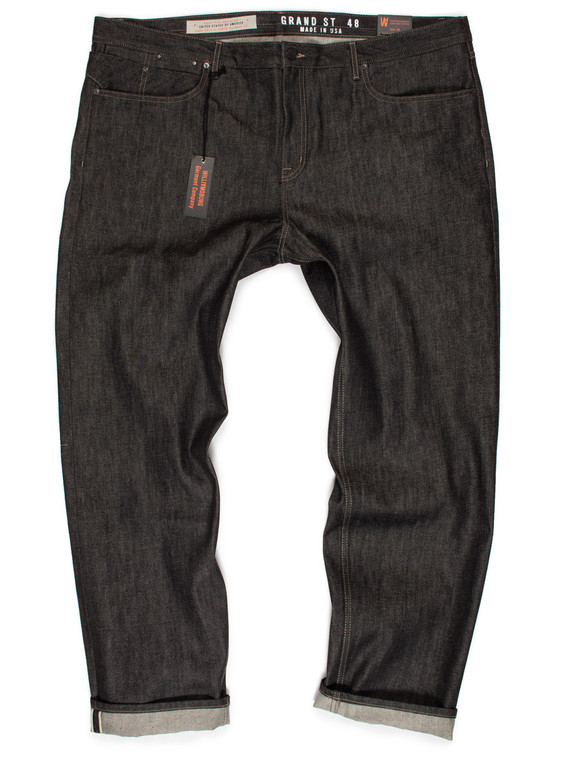 Big men's slim black selvedge raw denim jeans made in USA. Jeans size 48 pictured, but sizes range from 40 to 50.