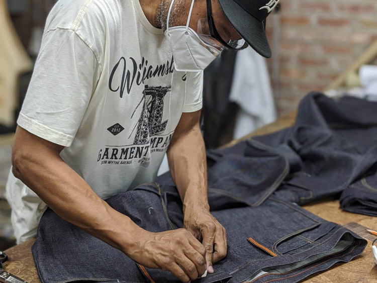 Blog post features designer Maurice Malone making jeans inside the WGC workshop