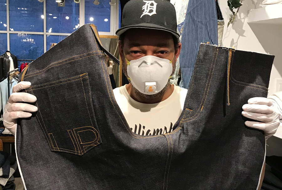 Designer Maurice Malone works in protective N95 mask & gloves in Williamsburg, Brooklyn shop