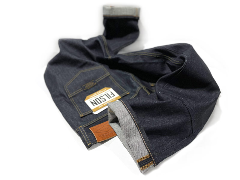 Chain stitch hemming alterations on hem of Filson double-front knee jeans