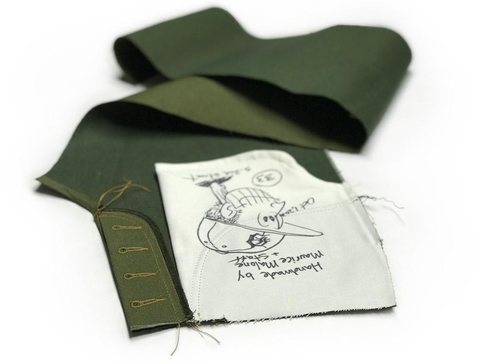 Handmade custom green Japanese denim jeans in work.