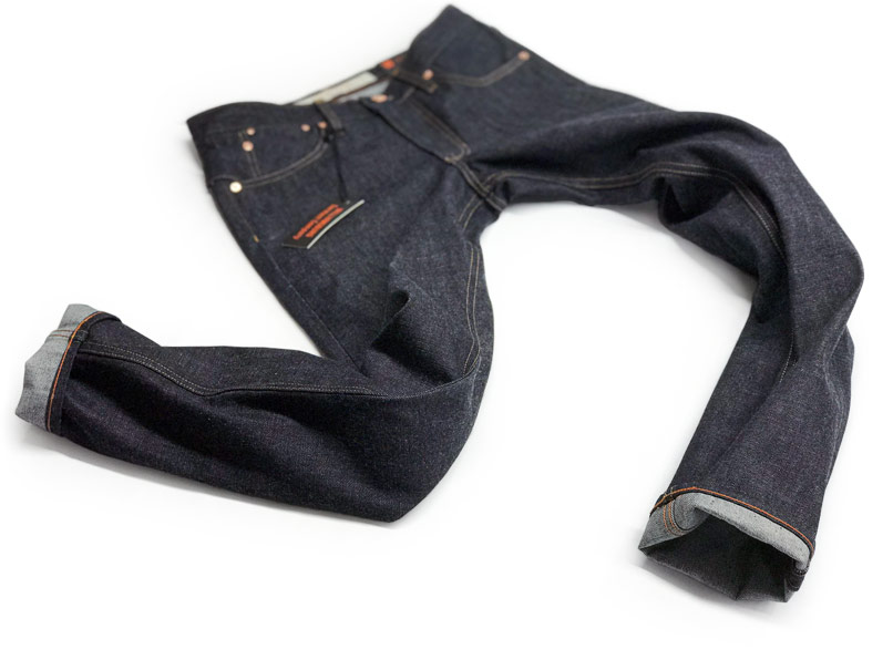 Handmade by designer Maurice Malone & staff, slim tapered raw jeans custom made in NYC with Cone White Oak denim.